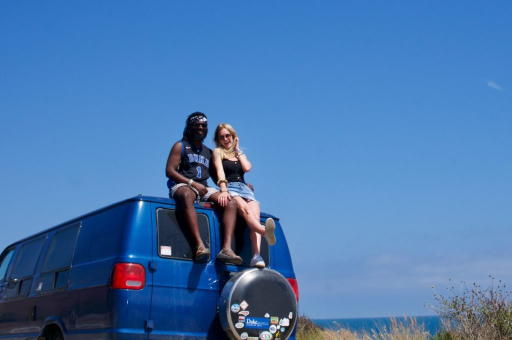 Rachel and Ola sitting on Top of their van Bertie